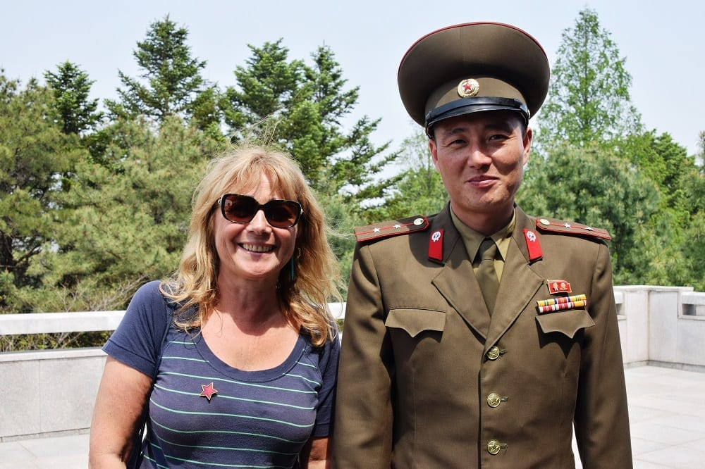 Sue and a Korean soldier at the DMZ in North Korea