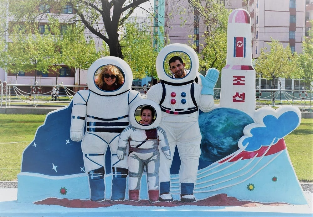 Sue, Giorgio and Charlotte pose as astronauts at a park in Pyongyang