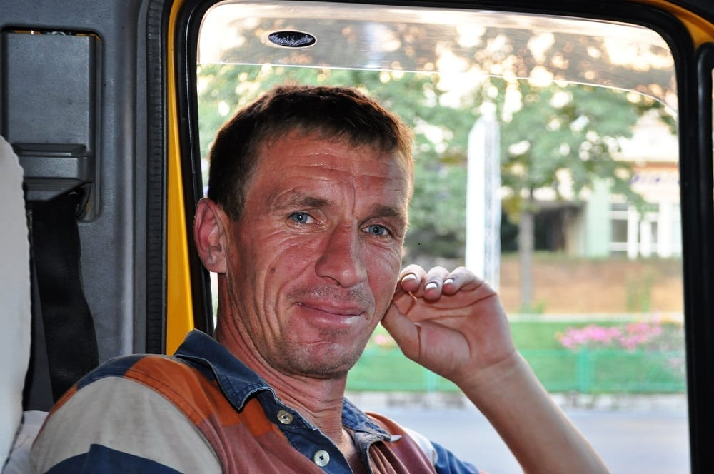Portrait of driver Reynard in the minibus Kyrgyzstan