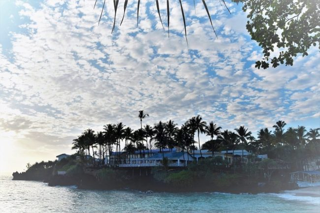 Fabulous fluffy clod patterns over the waving palm trees and the Grand Hotel Tulip Comoros