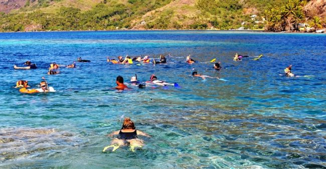 Snorkellers in the lagoon at bora Bora