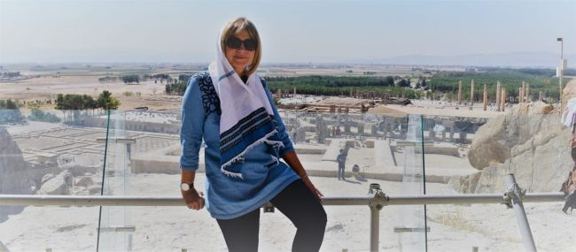 Sue dressed for Iran, Persepolis in the background
