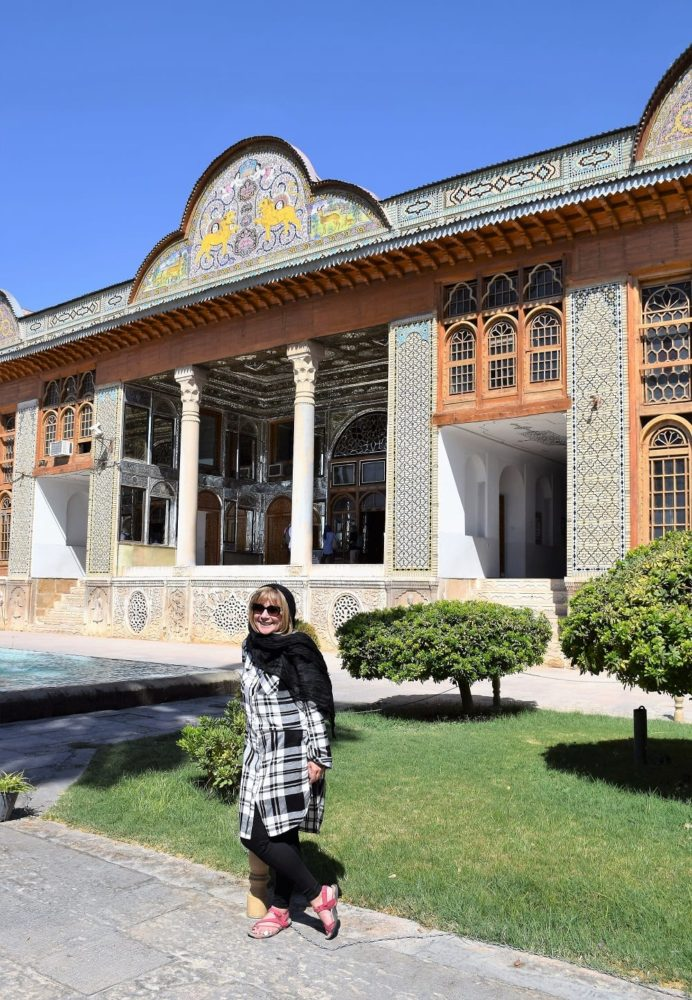 Sue dressed for Iran, in front of the Eram Palace in Shiraz