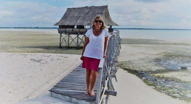 Sue on the boardwalk leading to her overwater stilt house