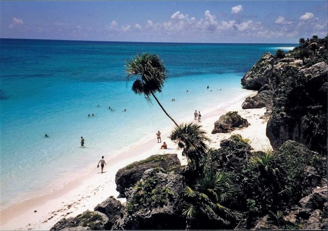 Panoramic view of the cliffs, white sand and turquoise sea at Tulum