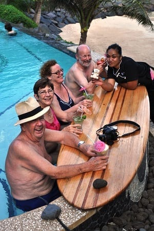Hotel guests drinking cocktails in the pool with Teen Tiny Bear