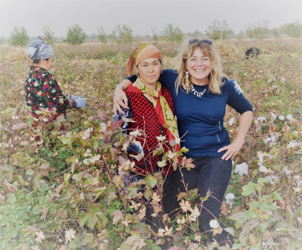 Sue in the field with the cotton pickers in Tajikistan