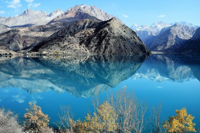 Mountains beautifully reflected in the turquoise water at Iskanderkul Tajikistan