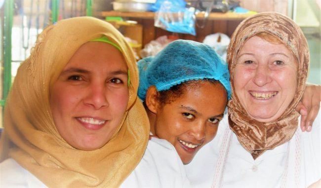 Three Lebanese women pose in a shop