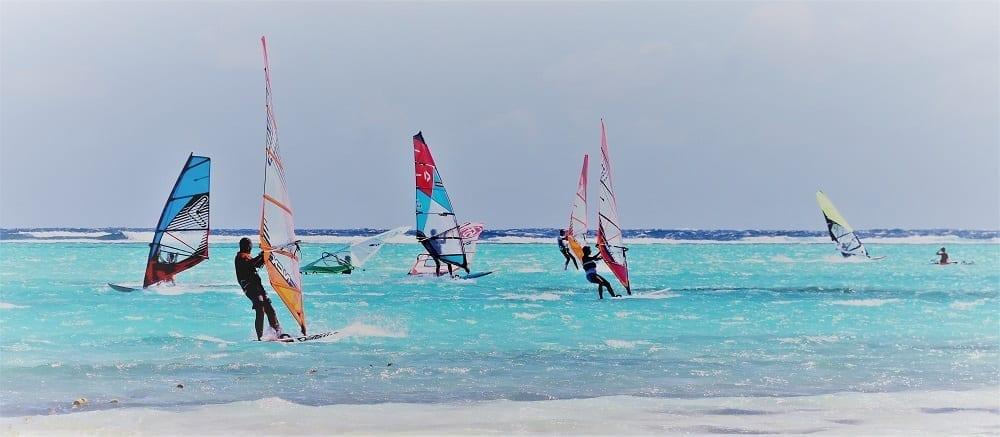 Colourful windsurfers on a turquoise sea