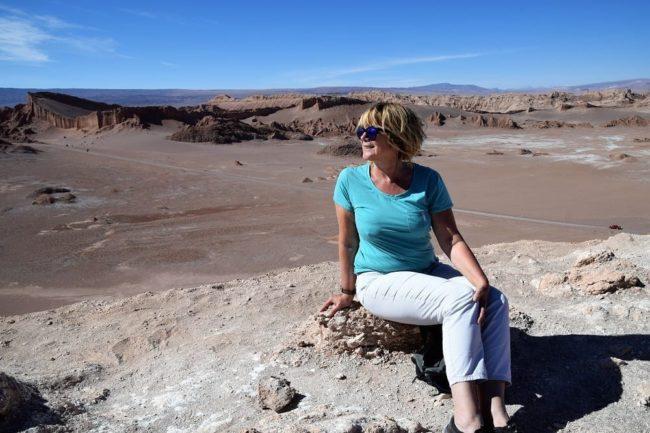 Sue sitting on a ridge above Lunar Valley, Atacama