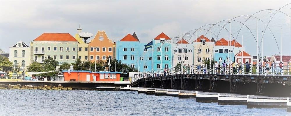 Bright painted town houses on the quay next to the pontoon bridge at Willemstad