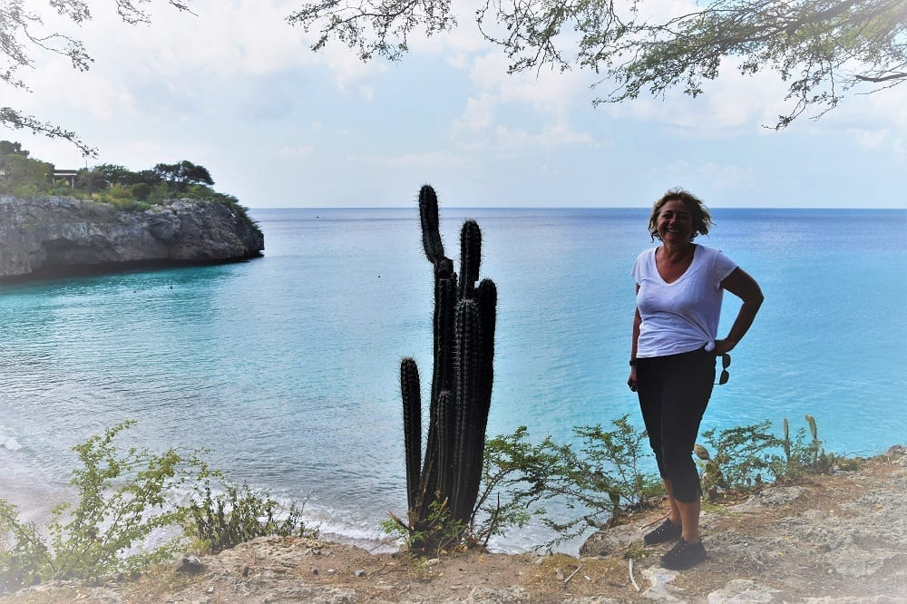 Sue above the bay and next to a tall cactus, Playa Jeremi, Curacao