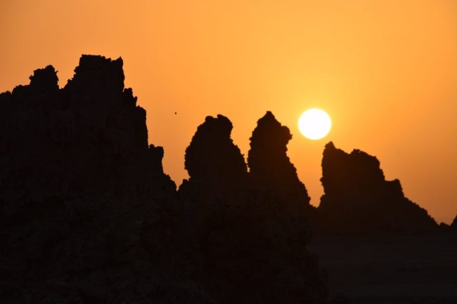 Sunset over the A view across the geothermal chimneys of Lac Abbe, Djibouti