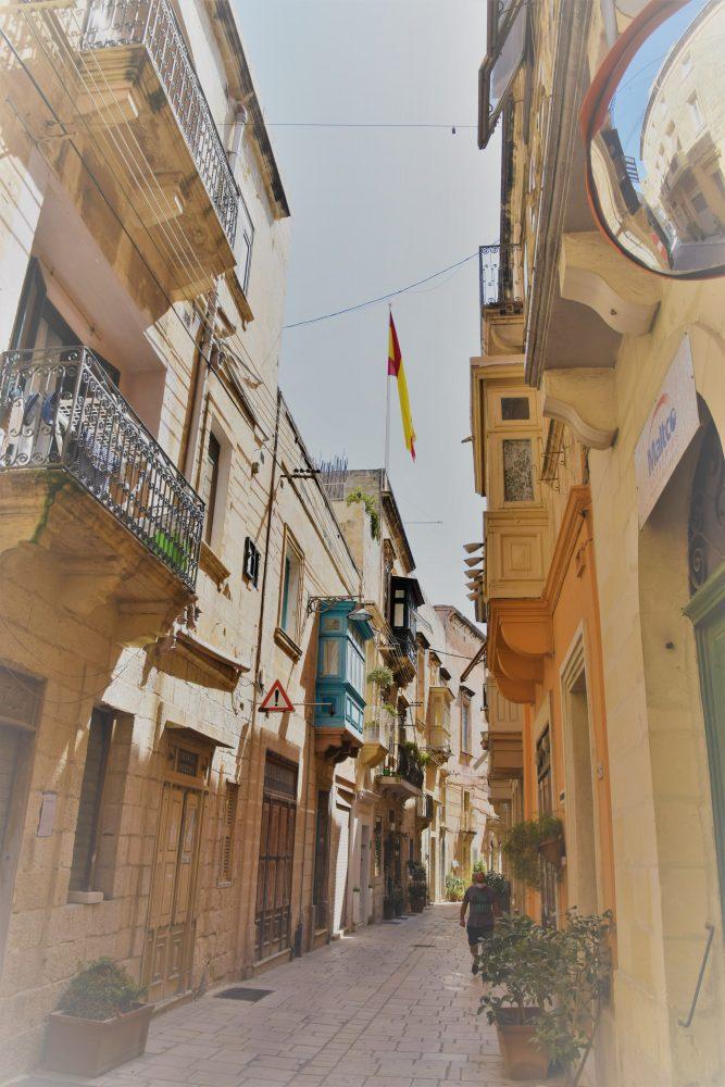 A narrow balconied street in Vittorioso