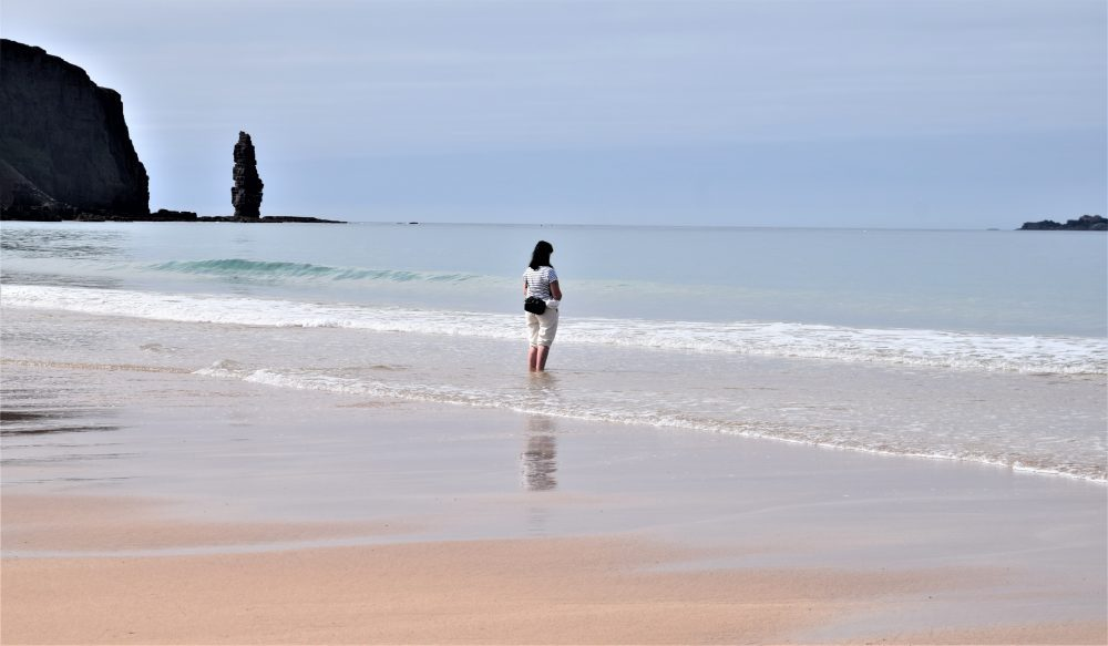 Vicky in the shallows by the stack at Sandwood Bay Scotland