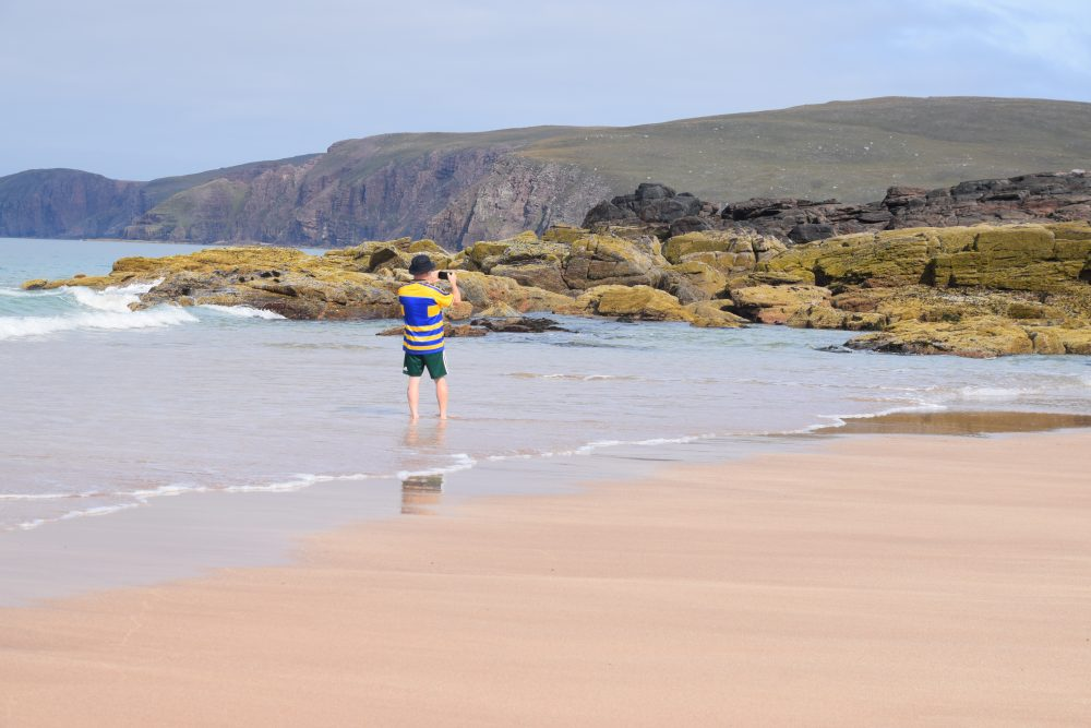 Tim photographs the rock formations at Sandwood Bay Beach, Scotland