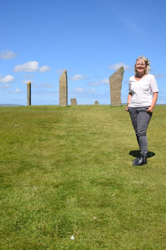 Sue in front of the Standing Stones at Stenness, Scotland