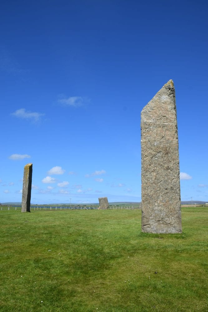 A close up of one the Standing Stones at Stenness, two others in the background Scotland