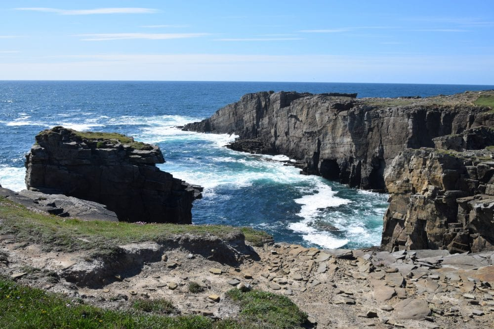 Sheer cliffs and swirling seas at Yesnaby, Scotland