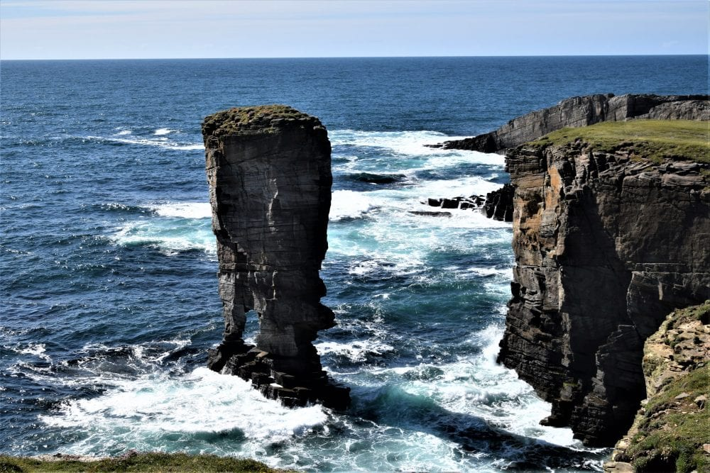 The Yesnaby Castle stack, surrounded by foaming turquoise pools
