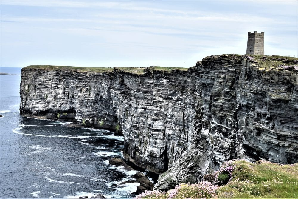 The seabird cliffs at Marwick Head with the Kitchener Memorial tower on top, Orkney