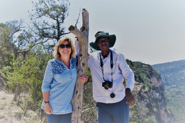 Sue and Mohammed sating on the ridge at Ga'an Libah
