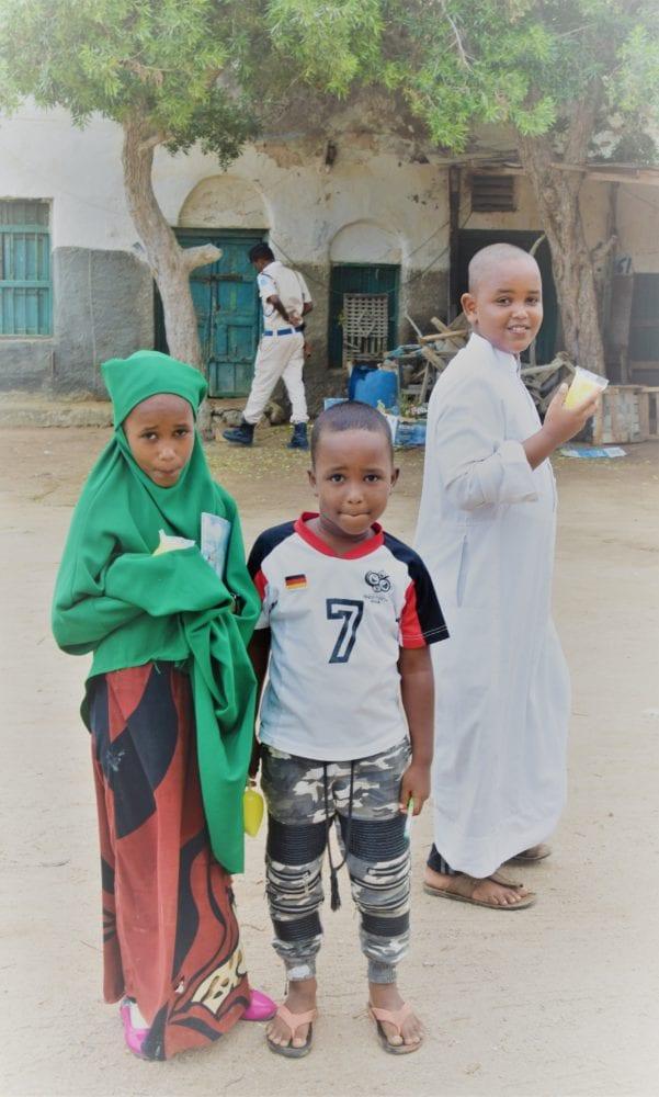 Three children posing in a square at Berbera