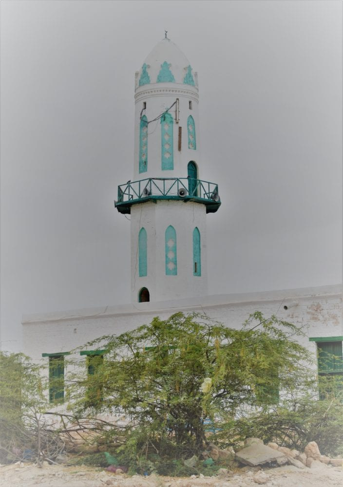 A green and whiteminaret at Berbera