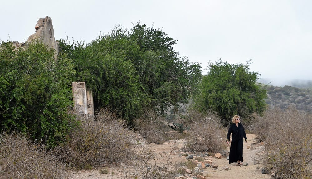 Sue wearing her black abaya in the grounds of the ruined governor's' house