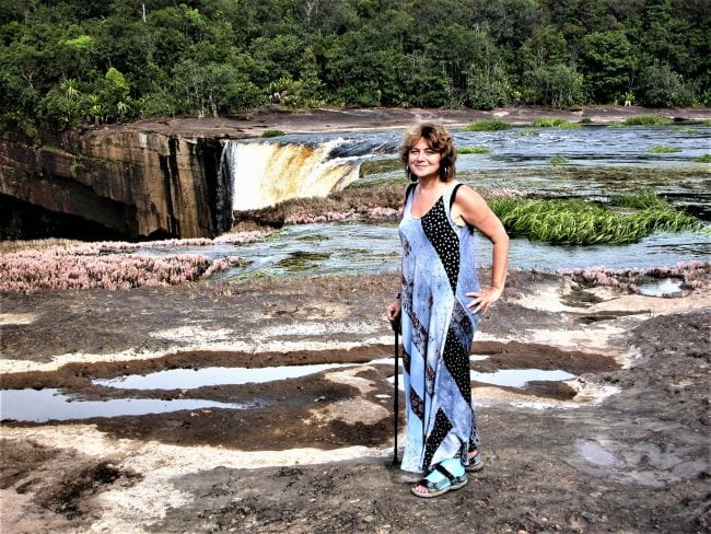Sue with her leg in plaster at the edge of the Kaiteur Falls Guyana