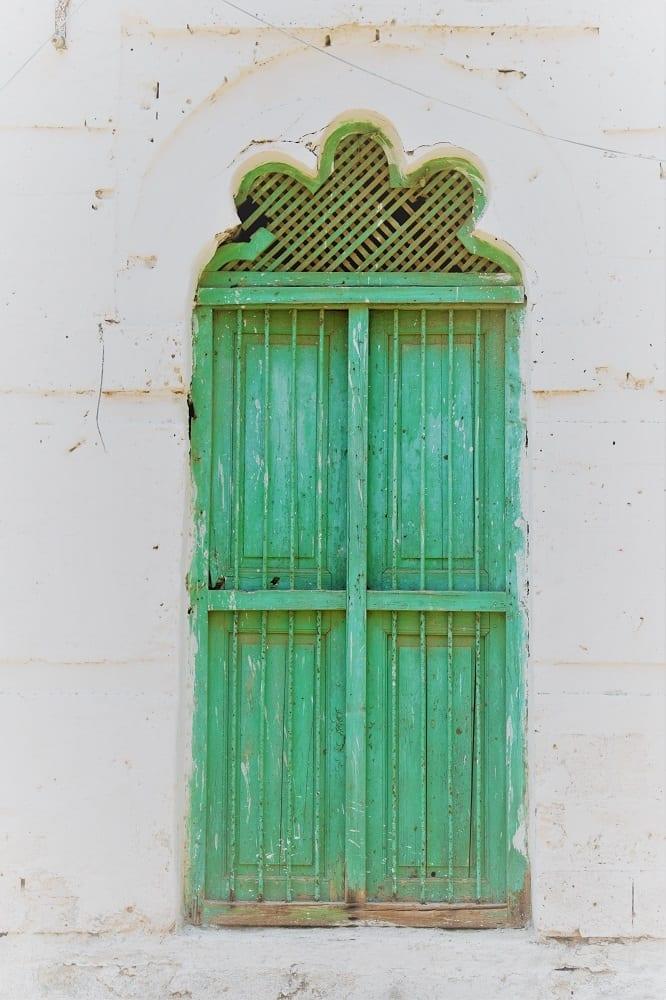 A decorated green window in Massawa