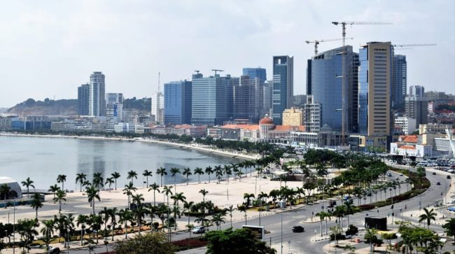 Bay of Luanda lined with oil boom scrapers