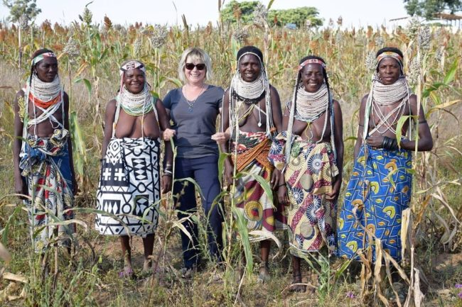 Sue with Handa women with huge beaded necklaces in the corn in Angola
