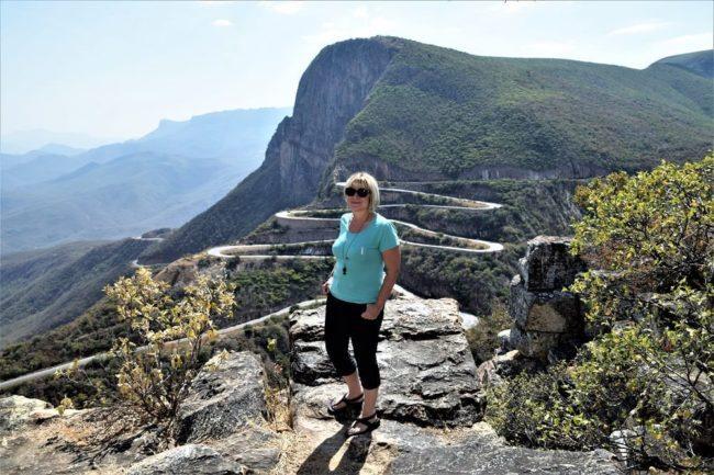 Sue standing in front of the snaking Serra da Leba Pass