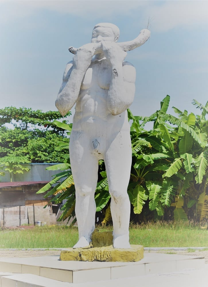 A statue of a man blowing a horn