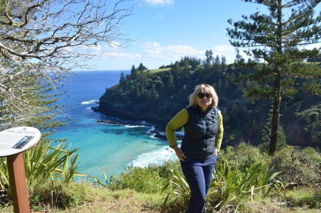 Sue standing above pretty Anson Bay on Norfolk Island