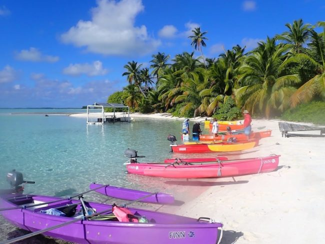 Colourful canoes lined up on the beach in the southern atoll of the Cocos Islands