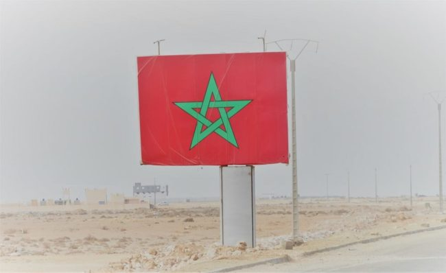 A huge Moroccan flag by the wayside in Western Sahara