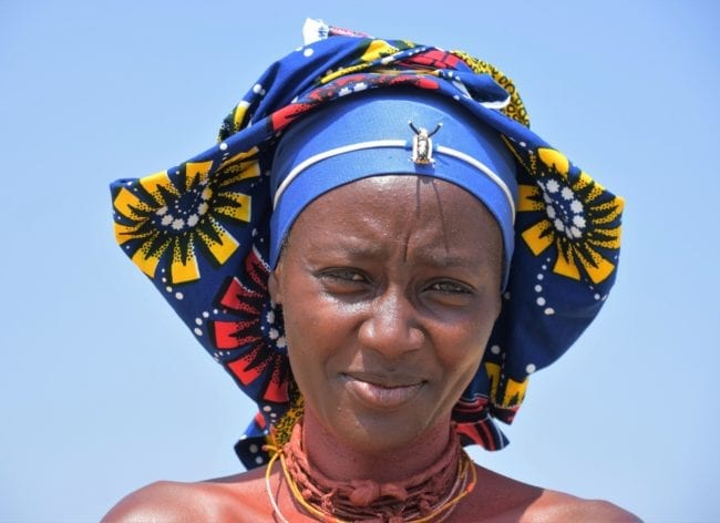 Mucabal woman with gorgeous flowery headdress