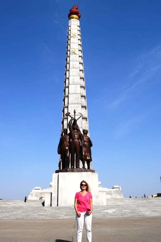 Sue in front of the Juce Tower in Pyongyang