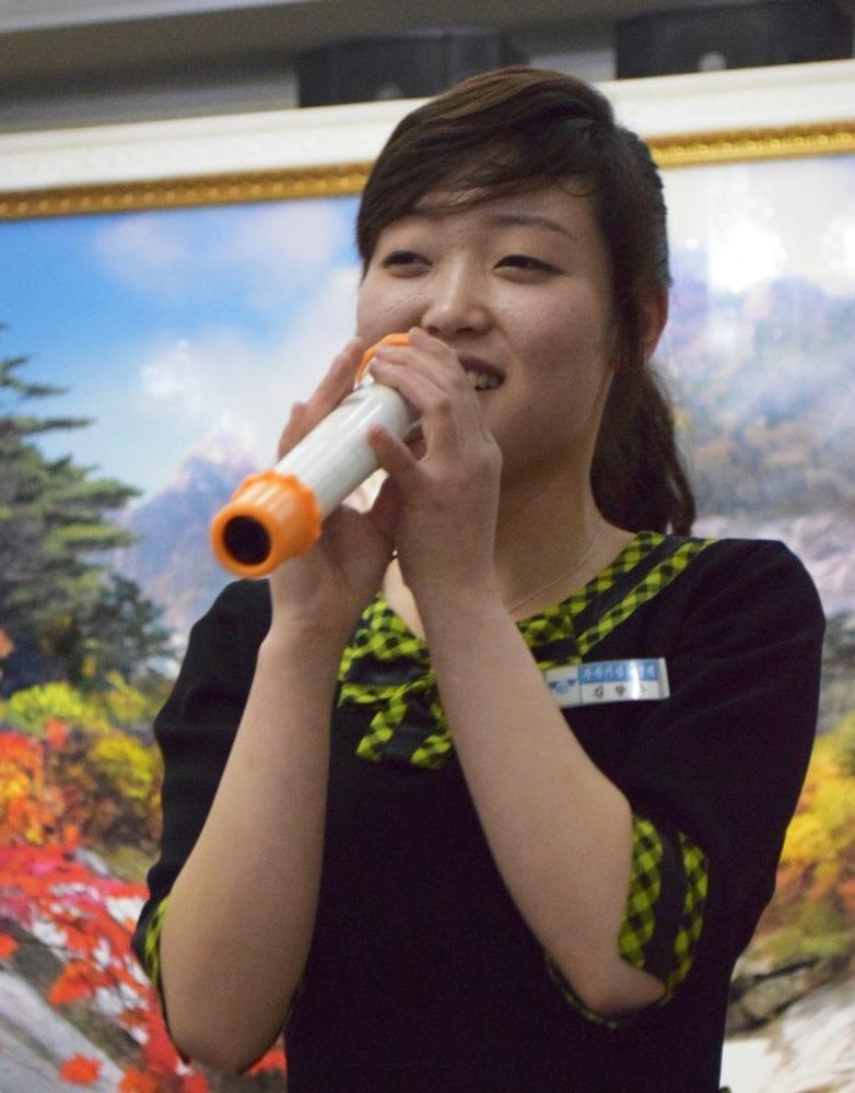 A karaoke singing waitress in Pyongyang