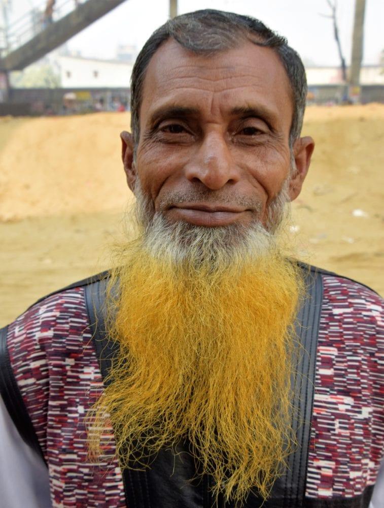 Bangladeshi man with a long henna dyed beard