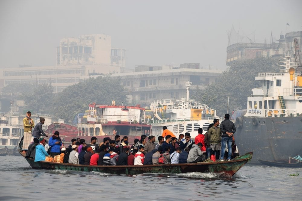 A ferry boat crammed with passengers on the Buriganga River in Dhaka