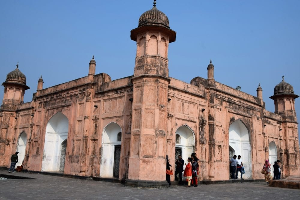 Lalbagh Fort - view from one corner showing three towers and several white arched windows and doors