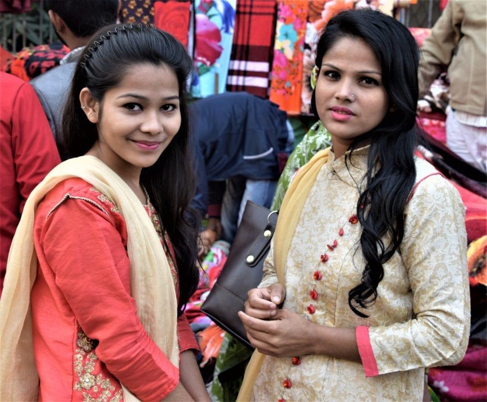 Portarit of two beautiful Bangladeshi girls with flowing dark hair