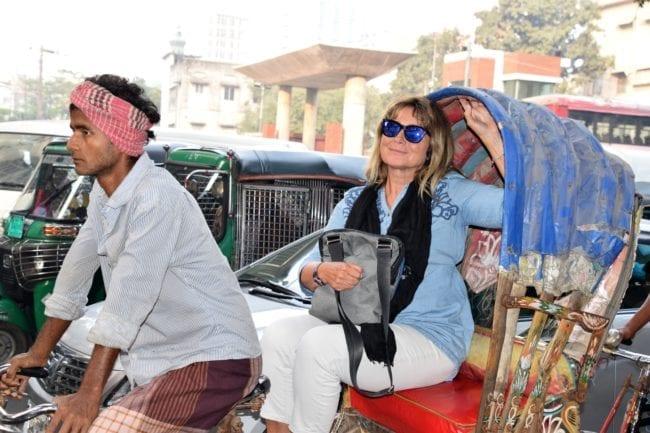 Sue braving a cycle rickshaw in the traffic of Dhaka