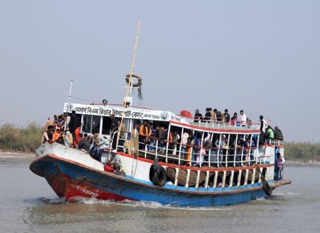 Packed passenger ferry on the Padma River Bangladesh