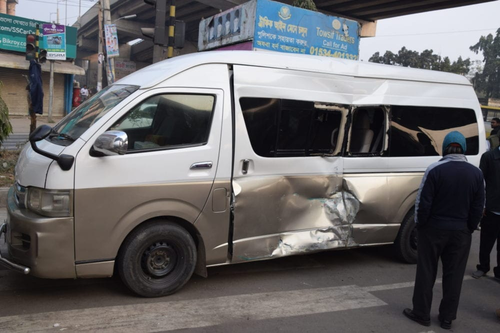 Our badly dented van after the accident in Dhaka