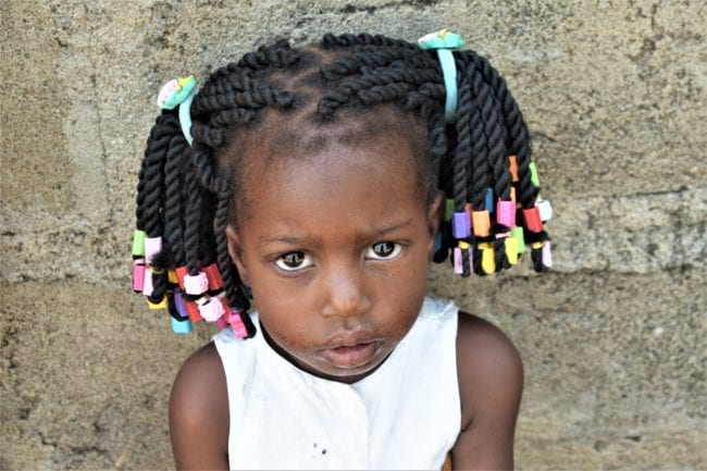 Portrait of a young girl with beautifully beaded cornrows